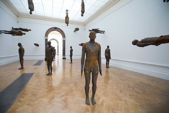 Antony Gormley, <em>Lost Horizon I</em>, 2008. 24 cast iron bodyforms, each 74 1/2 x 20 3/4 x 11 1/2 inches. Installation view, Royal Academy of Arts, London, 2019. © Antony Gormley. Photo: David Parry, © Royal Academy of Arts.