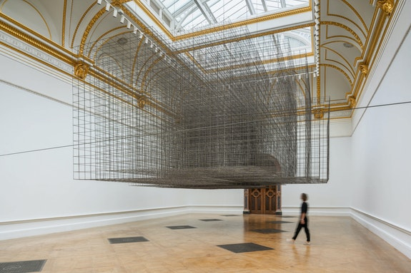 Antony Gormley, <em>Matrix III</em>, 2019. Approximately 6 tons of 6 mm mild steel reinforcing mesh, 279 1/2  x 366 x 595 1/2 inches. Installation view, Royal Academy of Arts, London, 2019. © Antony Gormley. Photo: © Oak Taylor-Smith.