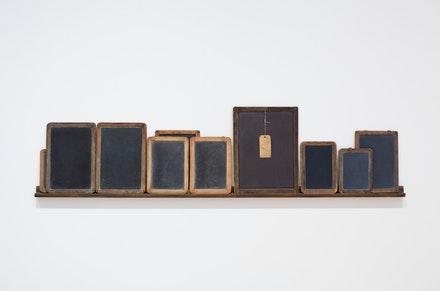 Vija Celmins, <em>Blackboard Tableau #1</em>, 2007–10. Three found tablets and seven made objects (wood, acrylic paint, alkyd oil, pastel, string, paper, and graphite), 8 1/4 x 6 1/4 x 3/8 inches, 8 5/8 x 6 5/8 x 1/4 inches, 10 x 7 x 1/4 inches, 10 5/8 x 7 7/8 x 1/4 inches, 10 3/4 x 7 3/4 x 1/4 inches, 11 7/8 x 8 1/2 x 3/8 inches, 12 x 8 3/8 x 3/8 inches, 13 3/8 x 9 3/8 x 1/4 inches, 13 3/8 x 9 1/2 x 1/4 inches, 16 1/2 x 12 1/4 x 3/8 inches. © Vija Celmins. Courtesy the artist and Matthew Marks Gallery