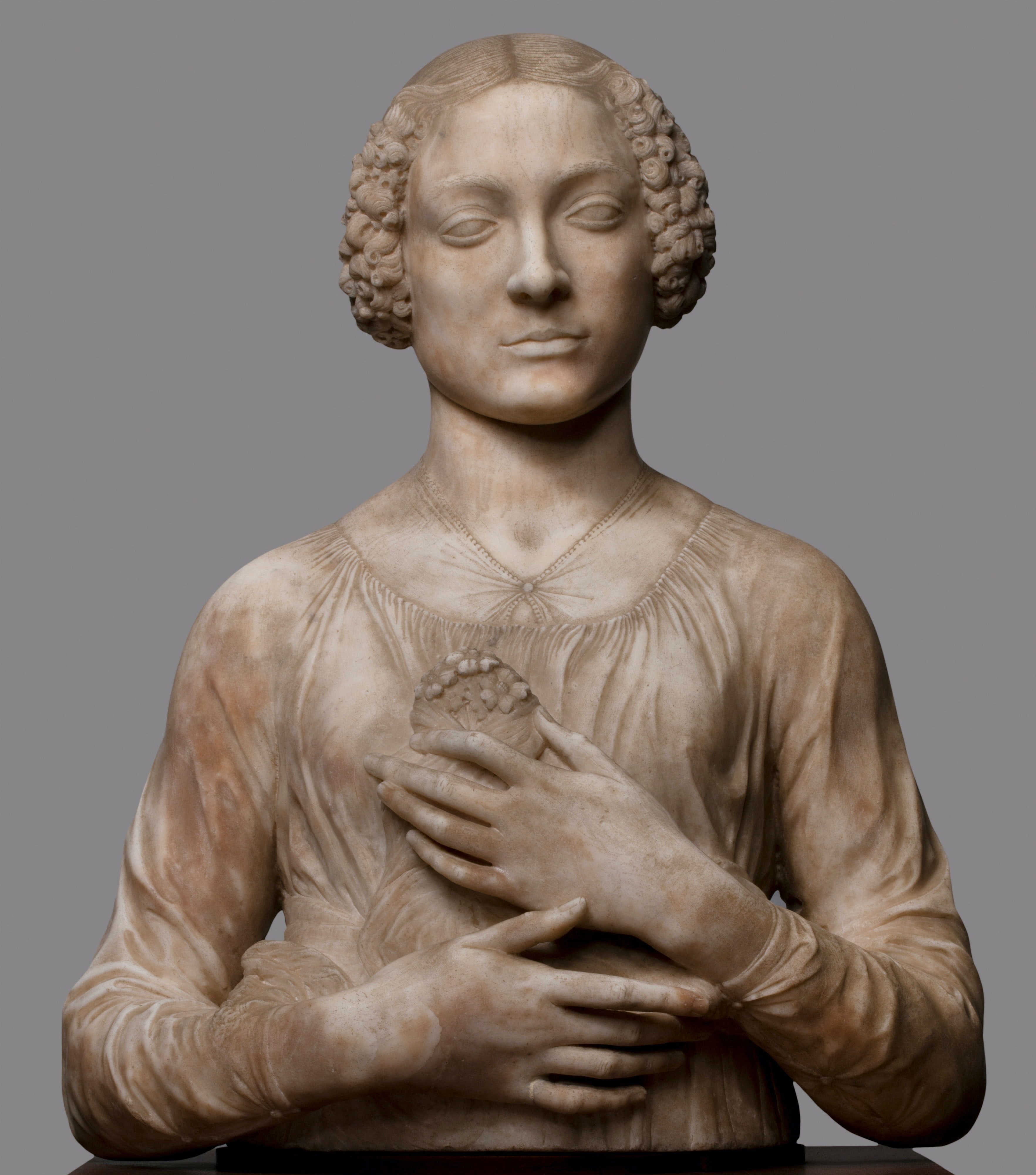 Andrea del Verrocchio, <em>Lady with Flowers</em>, c. 1475–1480. Marble, 23 5/8 x 18 7/8 x 9 13/16 inches. Museo Nazionale del Bargello, Florence.