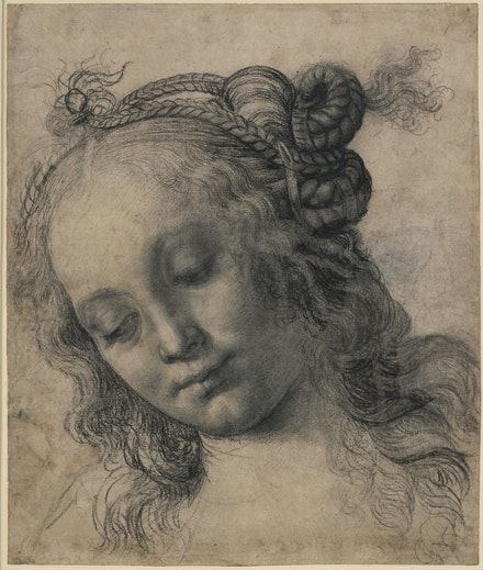 Andrea del Verrocchio, <em>Head of a Woman with Braided Hair</em>, 1475. Black chalk or charcoal, lead white gouache, pen and brown ink, reworked with oil charcoal on cream prepared paper, 12 3/4 x 10 3/4 inches. © The Trustees of the British Museum, London. All rights reserved.