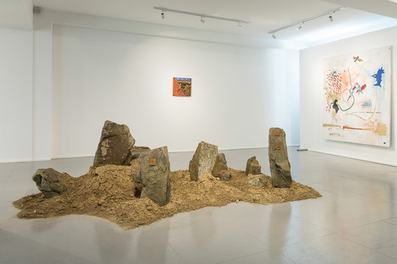 Shotiko Aptsiauri, Installation view, <em>Niches of Garamantes</em>, 2019, Installation: stones and soil with clay plates, 60 x 310x200 cm, Photo: Guram Kapanadze. Courtesy of the artists and Window Project Gallery.