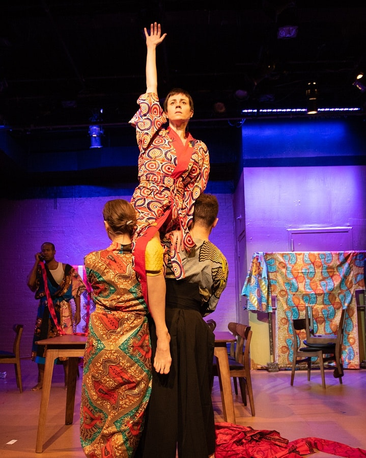 Laura K Nicoll (center), supported by Cooper Howell (left) and Lynn R. Guerra (right) in <em>BrandoCapote</em>. Rafael Jordan in background. Photo: Miguel Aviles.