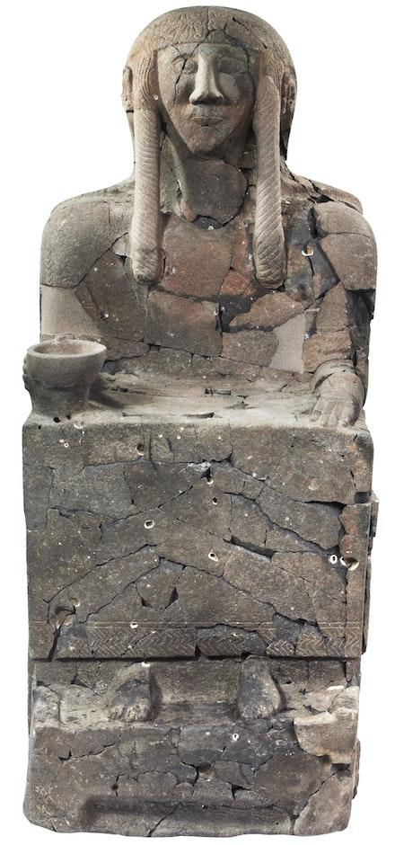 <em>Seated figure</em>, Neo-Hittite, c.10th–9th century BC (reconstructed 2001–10), Tell Halaf (ancient Guzana), Syria. Basalt, 75 5/8 x 32 1/4 x 39 3/8 inches. Max Freiherr von Oppenheim Foundation, Cologne.
