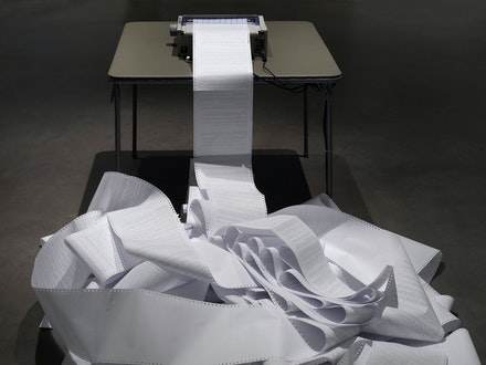 Hans Haacke, <em>News</em>, 1969/2008. OKI microline 590N 24-pin printer with newsfeed on table and roll of paper, dimensions variable. Courtesy the artist and Paula Cooper Gallery, New York.
