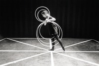 "Juliet Neidish rehearsing ""Hoop Dance"" at the Bauhaus in Dessau, 1994. Photo: Mark Franko."