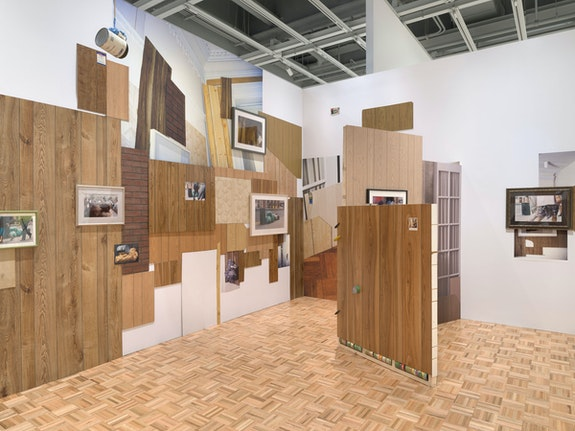 Installation view: <em>Rachel Harrison Life Hack</em>, Whitney Museum of American Art, New York, 2019--2020. <em>Should home windows or shutters be required to withstand a direct hit from an eight-foot-long two-by-four shot from a cannon at 34 miles an hour, without creating a hole big enough to let through a three-inch sphere?</em>, 1996/2019. Photo: Ron Amstutz.