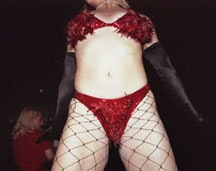<i>Julie Atlas Muz onstage in red bikini, Fez Under Time café, NYC 2001. Courtesy of Lisa Kereszi/Pierogi.</i>