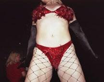 <i>Julie Atlas Muz onstage in red bikini, Fez Under Time café, NYC 2001. Courtesy of Lisa Kereszi/Pierogi.</i>