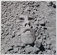 David Wojnarowicz, <em>Untitled (face in dirt)</em>, 1991. Silver print, 19 7/8 x 23 3/4 inches. Courtesy the Estate of David Wojnarowicz and P·P·O·W, New York.