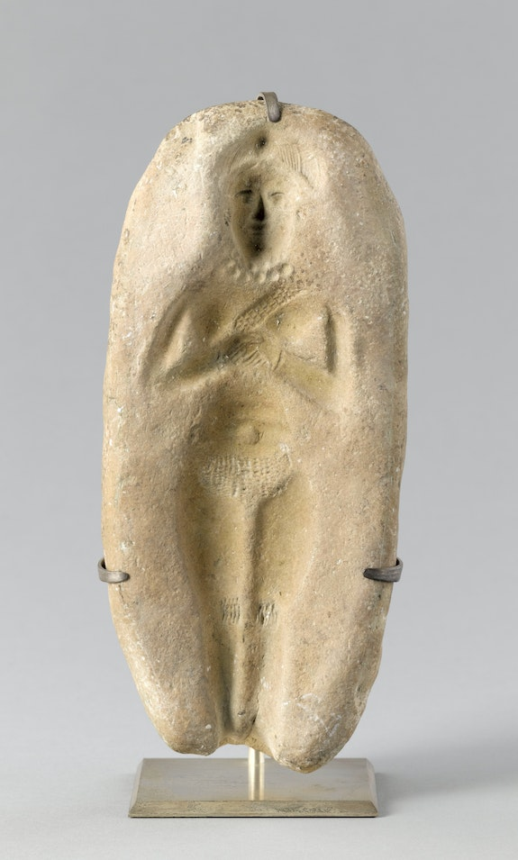 Mold for a female figurine, Middle Elamite Period, c. 1500-1100 BCE, Susa, Iran. Molded baked clay. Musée du Louvre, Paris. © RMN-Grand Palais / Art Resource, NY. Photo: Franck Raux.