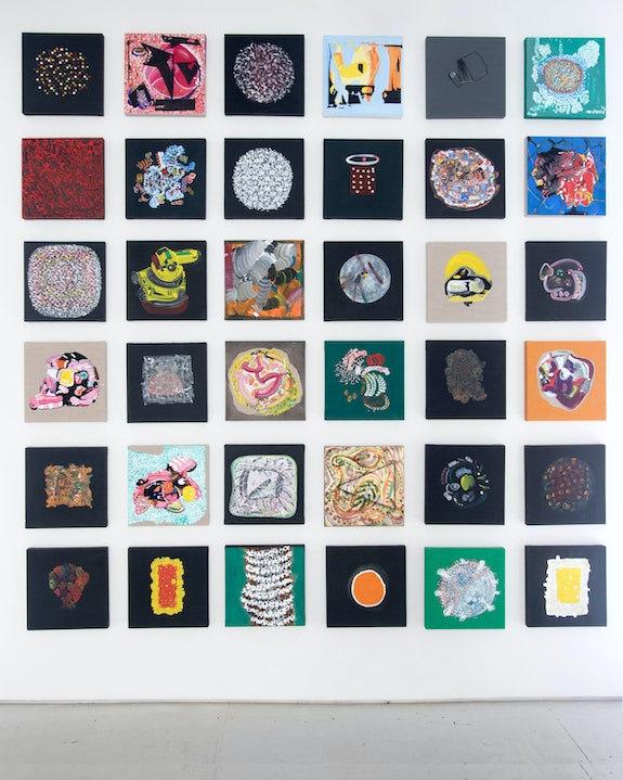 Thomas Kovachevich, <em>36 Squares</em>, 2011 - 2015, Acrylic on linen, 12 x 12 inches (each). Installation view from Dark Star: Abstraction and Cosmos, Planthouse Gallery, New York, 2016.