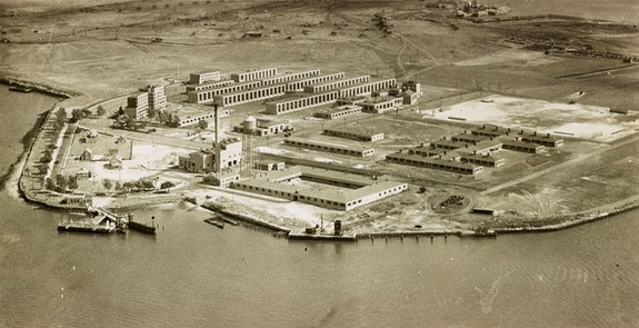 Aerial view of unfinished Rikers Island penitentiary buildings, c.1930s. Courtesy NYC Municipal Archives.