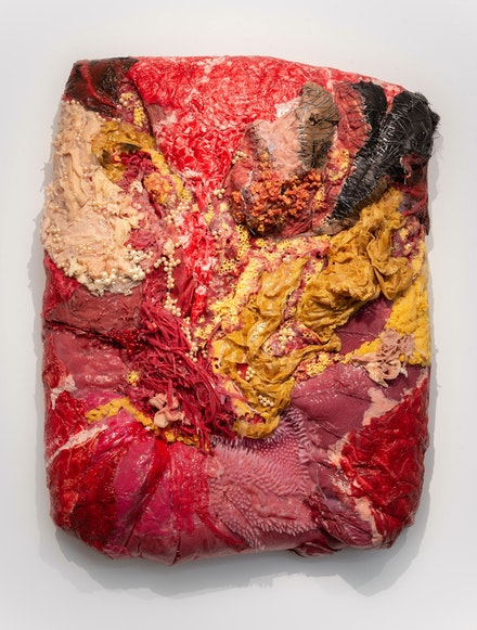 Doreen Garner, <em>After Her Flag</em>, 2020. Urethane foam, silicone, latex, pearls, staples, hair weave, steel wire, glass beads, steel pins, 36 x 27 x 8 inches. Courtesy the artist and JTT, New York.