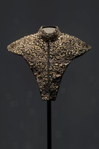 Teresa Margolles, <em>El Brillo: One homicide can change the world (Un homicidio puede cambiar el mundo)</em>, 2020. Garment hand-embroidered in goldwork bullion style with glass shards from a site where violent acts occurred in El Paso, TX, U.S.A., 2019, 24K gold thread, bullion, tulle, lochrose crystals, display form. © Teresa Margolles 2020. Image courtesy the artist and James Cohan, New York. Photo: Phoebe d'Heurle.