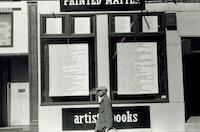 Window Installation by Jenny Holzer at Printed Matter's Lispenard Street location, 1979. Photo: Nancy Linn.