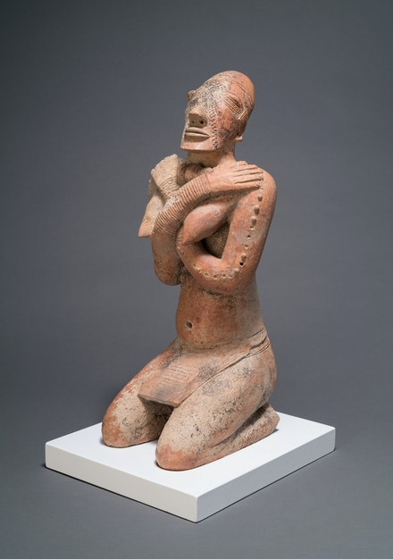 Kneeling Female Figure with Crossed Arms, Middle Niger civilization, Mali, 12th–14th century. Terracotta. The Menil Collection, Houston. Courtesy the Menil Collection.