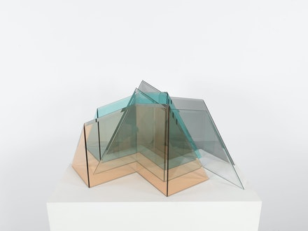 Larry Bell, <em>Glacier</em>, 1999. Pink Rosa tinted glass, Azure Blue tinted glass, Light Grey tinted glass, Clear glass, 16 x 29 1/2 x 35 inches. © Larry Bell. Private collection. Photo: Christopher Burke.