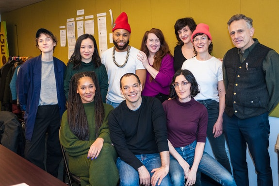 <em>The Lunch Bunch team</em>, at their first rehearsal. Top (left to right): Playwright Sarah Einspanier; actors Tina Chilip, Ugo Chukwu, Julia Serna-Frest, Keilly McQuail, Mel Krodman, and David Greenspan. Bottom (left to right): actors Olivia Philip, Paco Tolson, and director Tara Ahmadinejad. Photo: Richard Bowditch.