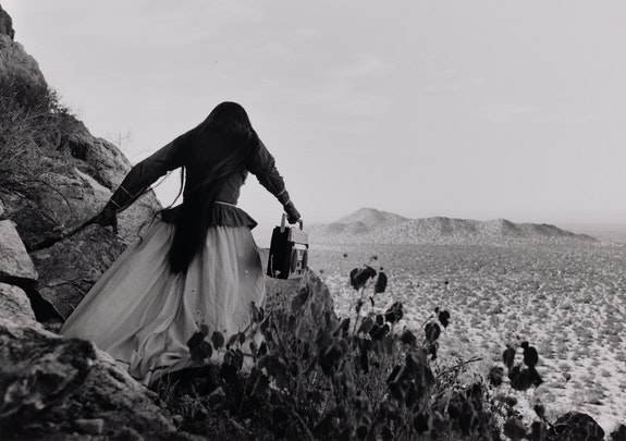 Graciela Iturbide, <em>Mujer Ángel (Angel Woman), Sonoran Desert</em>, 1979. Gelatin silver print, 13 x 18 3/8 inches. Collection of Elizabeth and Michael Marcus. © Graciela Iturbide. Courtesy Museum of Fine Arts, Boston.