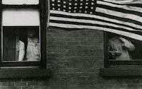 Robert Frank, <em> Parade - Hoboken, New Jersey, </em> 1955. © Andrea Frank Foundation, from <em> The Americans </em>