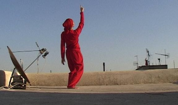 <em>Roof Piece Tehran</em>, Performance, 2011. Courtesy: Anahita Razmi