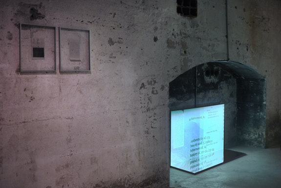 Jesse Chun, <em>untitled (wrdpwrmdesy)</em>, book pages, graphite, nails, aluminum frames, 11 x 14 inches each. INDEXING MY MONOLOGUE, single-channel video, 7 mins 25 secs, silence, mdf, mirror, 2020, courtesy of the artist, installation view at SculptureCenter