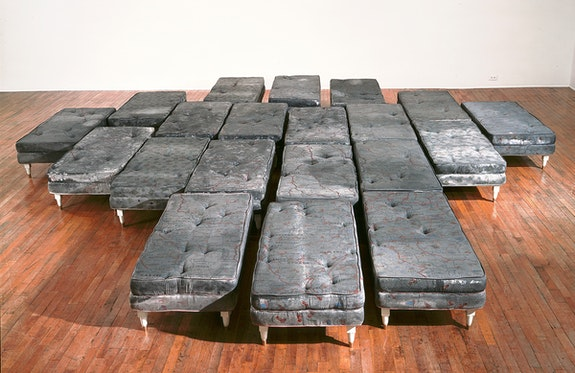 Guillermo Kuitca, Untitled, 1992. Acrylic on mattress with wood and bronze legs, 20 beds; 15 3/4 x 23 5/8 x 47 1/4 inches each. Tate, London. © Guillermo Kuitca. Courtesy the artist and Sperone Westwater, New York.