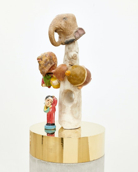 Bharti Kher, <em>Namaste Henry Moore</em>, 2019. Clay, cement, wax, copper/brass, 70 1/16 x 9 5/8 x 9 5/8 inches. Courtesy the artist and Perrotin. Photo: Alex Austin.