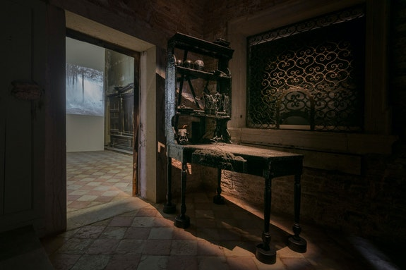 Lauren Bon, <em>St. Jerome's Study</em>, 2007. Mixed media: writer's desk, tar, capoc, wire, research books, ceramic seed pods, cow bones; 83 x 42 x 66 inches. Courtesy the artist and the Metabolic Studio, Los Angeles. Photo by Samuele Cherubini.