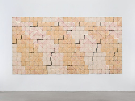 Allan McCollum, <em>Beauty is as Beauty Does</em>, 1972. Canvas squares, lacquer stain, varnish, silicone adhesive caulking, 70 x 135 inches. Courtesy Petzel Gallery, New York.