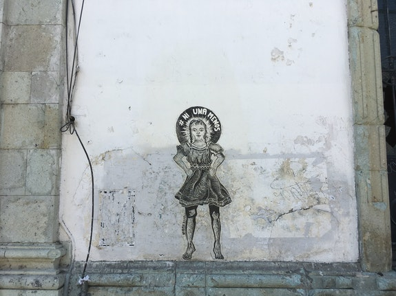 Woodcut by Elise Rubin, on a wall in Oaxaca, Mexico. Photo by the author.