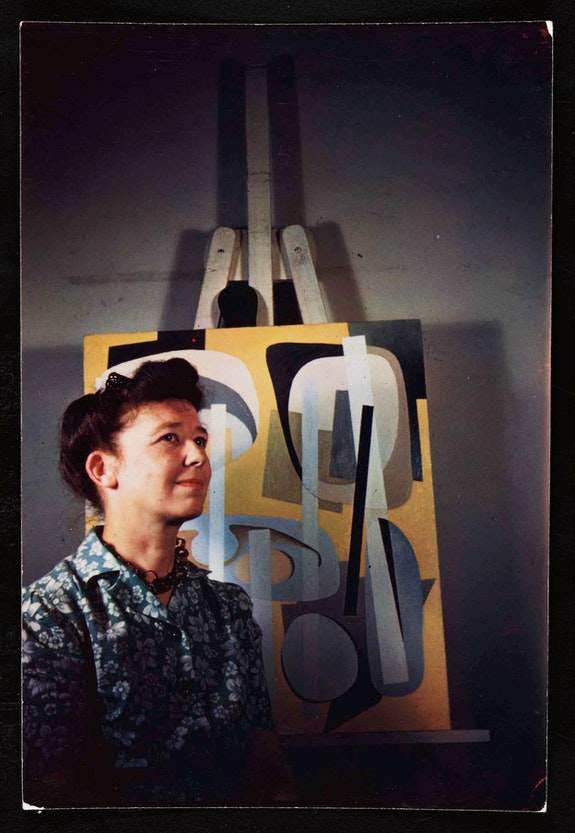 Alice Trumbull Mason with her painting <em>Bearings Charted with Yellow</em> (1946), September 1946. Photo by Charles Horowitz, courtesy of the Archives of American Art
