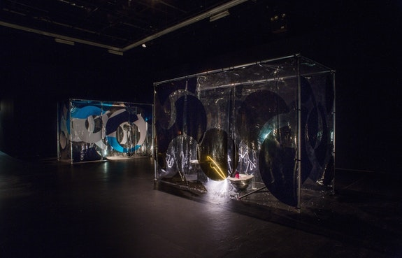 Anicka Yi,<em> Home in 30 Days, Don't Wash</em>, 2015. Vinyl, steel pipes, metal bowl, wire mesh, nylon string, DVD, black tea, foam, plasticine, neon light, hydro gel beads, plexiglas, sponge, worklight?. 78 × 122 × 50 inches. Courtesy the artist.