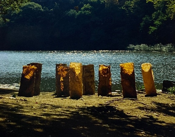Bilge Friedlaender, <em>Cedar Forest</em>, 1989. (installed in nature) Nine freestanding handmade linen paper sculptures, variable dimensions: 34 inches. © Mira Friedlaender. All rights reserved. Courtesy The Estate of Bilge Friedlaender.