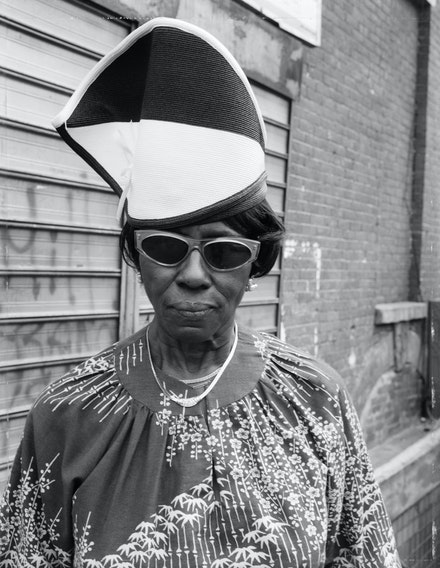"Dawoud Bey, <em>A Woman at Fulton Street and Washington Avenue</em>, from ""Street Portraits,"" 1988. Archival pigment print, 40 x 30 inches. © Dawoud Bey. Courtesy the artist, Sean Kelly Gallery, Stephen Daiter Gallery, and Rena Bransten Gallery."
