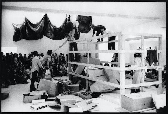 Grand Union in lobby of Walker Art Center, 1971. From left: Scott, Dilley, Lewis reaching toward Dilley, Brown bending over, Dunn also bending, Arnold. Photo: Tom Berthiaume, courtesy Walker Art Center.