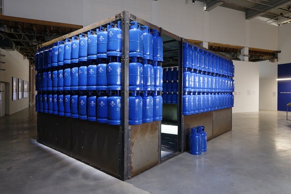 Amal Kenawy, <em>The Silent Multitudes</em>, 2010. Steel, LGP gas tanks, video, 300 x 600 x 400 centimeters. Exhibition view of <em>Our World is Burning</em>, Palais de Tokyo. Courtesy of Mathaf: Arab Museum of Modern Art (Doha)Photo: Aurélien Mole.