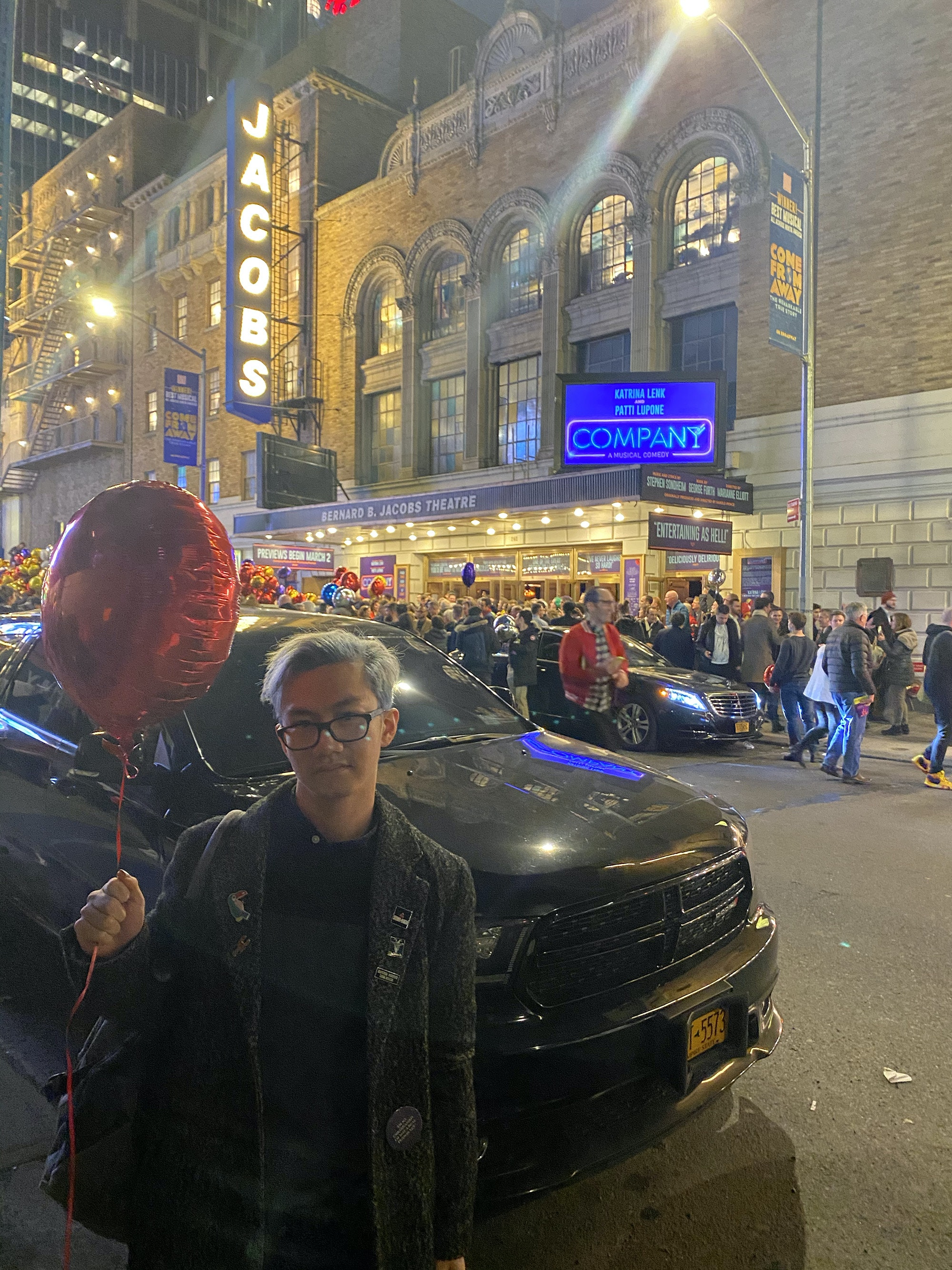 Kyle Turner outside the marquee for the Company revival, seen on Broadway earlier this year. Courtesy the author.