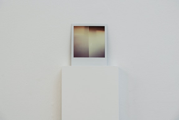 Rebeca Bollinger, <em>Untitled</em>, 1993, 2020. Polaroid SX70, wood, latex paint, 64 1/2 x 5 1/2 x 8 inches. Photo credit: Graham Holoch.