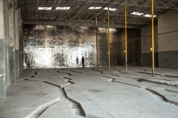 Michael Joo, <em>Locale Inscribed (Walking in the desert with Eisa towards the sun, looking down)</em>, 2014-2015. Intervention in existing site and silver nitrate. Commissioned by Sharjah Art Foundation. Installation view, Port of Sharjah, U.A.E., Sharjah Biennial 12, Sharjah, UAE. Photo: Deema Shahin.