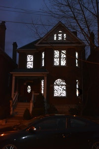 Melissa Vogley Woods, <em>Always</em>, 2020. Hand cut reflective photographic vinyl, tape. Scale of residential house. Neil Ave, Columbus, Ohio. courtesy the artist.
