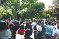 Protestors rallied in front of the statues at Academy Green in Kingston in response to the murder of George Floyd and to demand an end to police surveillance and brutality in the city. Photo: Stephanie Alinsug.