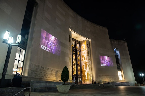 <em>Ephemeral Geometry</em> projected on the Brooklyn Library. Photo: Gregg Richards.