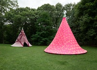 Installation view: <em>Leeza Meksin: Turret Tops</em>, with sun-bleached patterns unveiled, summer 2020, deCordova Sculpture Park and Museum, Lincoln, MA, 2020. Neoprene and galvanized steel, 240 x 246 inches. Courtesy the artist. Photo: Julia Featheringill Photography.