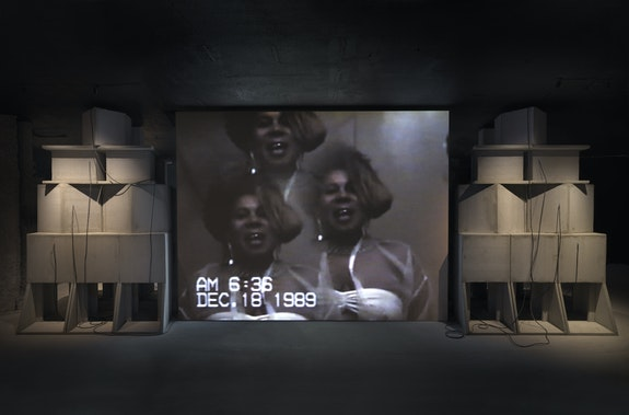 Akeem Smith, <em>Memory</em>, 2020, Single-channel video, custom speaker system, color photographs, steel, score by Alex Somers.Courtesy the artist and Red Bull Arts. Photo: Dario Lasagni.