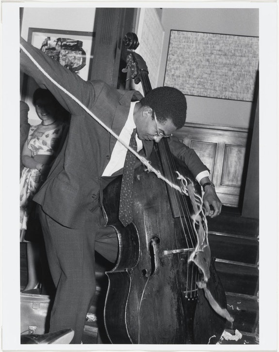 Benjamin Patterson (b. 1934) © Copyright. Variations for Double Bass. 1961. Performed by the artist at the Kleinen Sommerfest/Après John Cage, Galerie Parnass, Wuppertal, June 9, 1962. Gelatin silver print, possibly by Rolf Jährling, 9 1/4 x 7