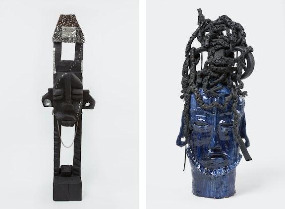 Left: Leilah Babirye, <em>Nabakka from the Kuchu Civet Cat Clan</em>, 2020. Wood, wax, aluminum, epoxy, acrylic, nails, found objects, 70 1/2 x 21 x 11 1/2 inches.  Right: <em>Nansamba O'we Ngabi from the Kuchu Antelope Clan</em>, 2020. Glazed ceramic, found objects, 45 x 22 x 14 1/2 inches. Courtesy Gordon Robichaux, NY. Photo: Greg Carideo.