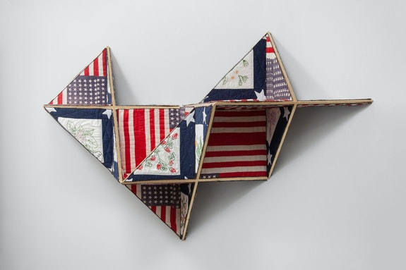 Sanford Biggers, <em>Reconstruction</em>, 2019. Antique quilt, birch plywood, gold leaf. 38 x 72 x 19 inches. Courtesy the artist and Monique Meloche Gallery, Chicago. Photo: RCH Photography.