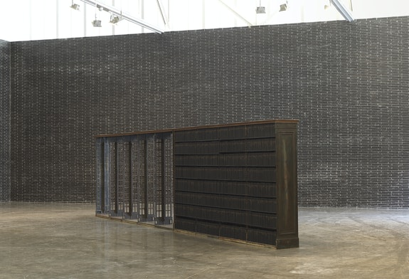Theaster Gates, <em>Walking Prayer</em>, 2018–20. Bound embossed books and vintage Carnegie cast iron shelving, 83 x 320 x 19 inches. © Theaster Gates. Photo: Robert McKeever. Courtesy Gagosian.